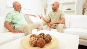 father-african-american-male-talking-home-with-elderly-father